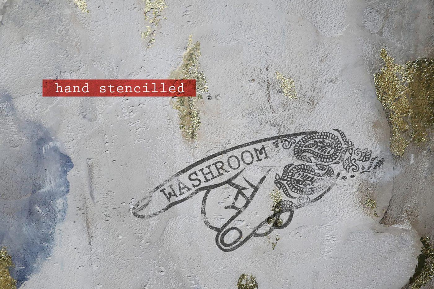 kricket-soho-london-bar-restaurant-design-interiors-washroom-wayfinding-sign-caption-2